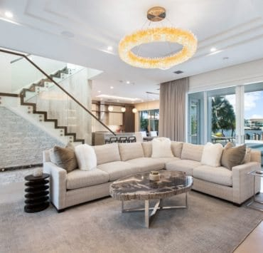 Selenite chandelier and pendants from RH Modern. Petrified wood coffee table from Robb Stucky. Custom fabric and couch from BernhardtRobb Stucky Credit Living Proof Real Estate Photography