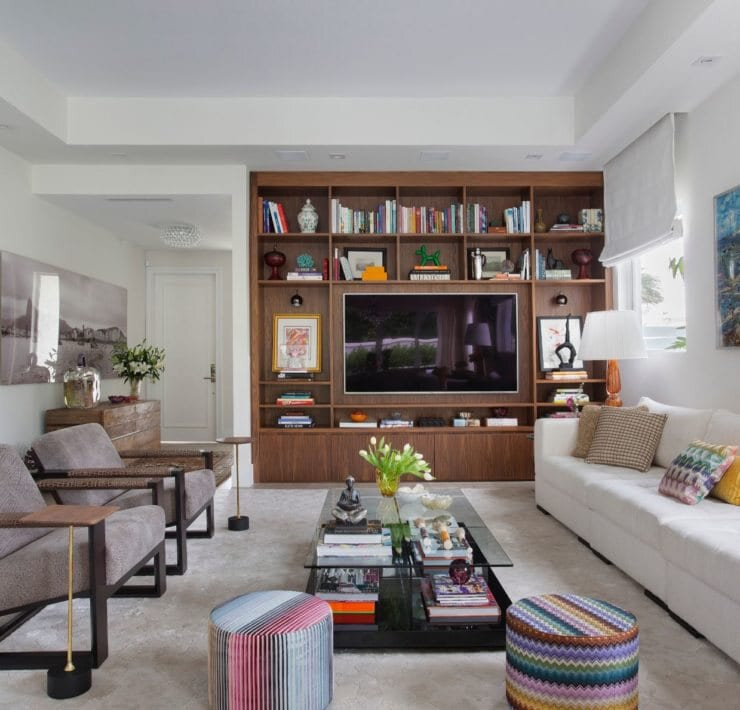 Custom made wall unit. Furniture from Artefacto. Poufs from Missoni Home. Accessories from One of a Kind Credit Denilson Machado