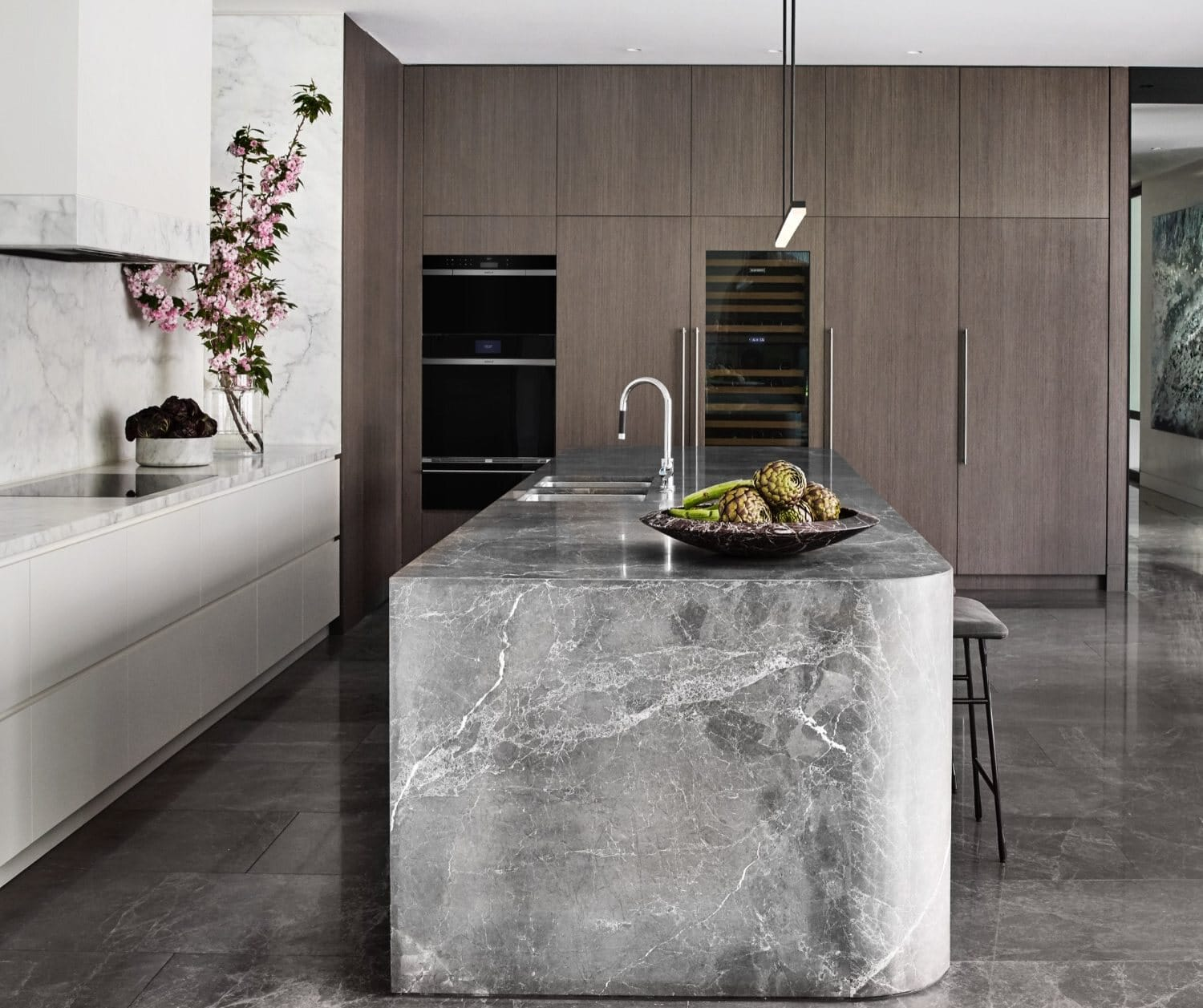 """Wolf 30"""" M Series Contemporary convection steam oven and built-in single oven; Wolf 36"""" Contemporary induction cooktop; Sub-Zero 30"""" Designer wine storage, column refrigerator and freezer, prices upon request; design by Miriam Fanning"""