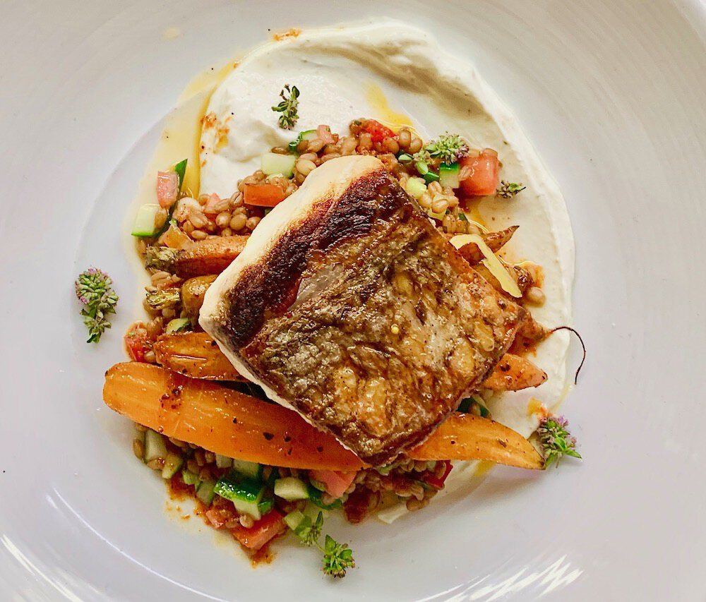 Almond Palm Beach's Striped Bass