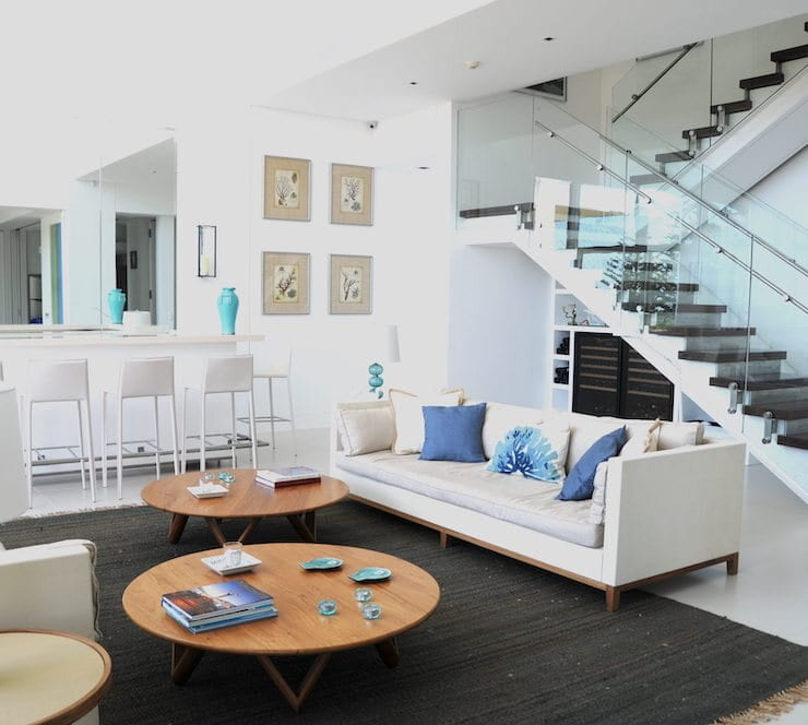 Area rug by Dash & Albert; sofas and coffee tables by Eugenio Aguirre; decorative pillows from Pottery Barn